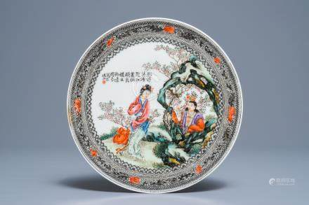 A Chinese famille rose plate with figures in a garden, Republic, 20th C.