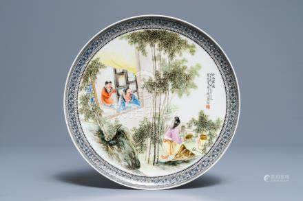 A Chinese fencai plate with figures in a garden, Republic, 20th C.