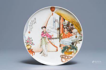 A Chinese famille rose plate with figures in an interior, Republic, 20th C.