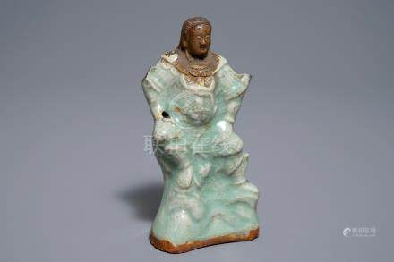 A Chinese Longquan celadon and biscuit figure of Zhenwu, Ming