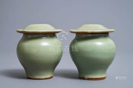 A pair of Chinese Longquan celadon vases and covers, Ming