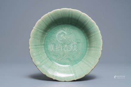 A Chinese Longquan celadon dish with underglaze peony design, Ming