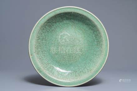 A large Chinese Zhejiang celadon-green charger, Ming