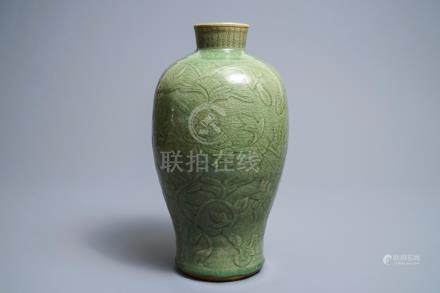 A Chinese Longquan celadon meiping vase with underglaze design, Ming
