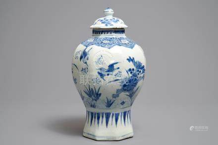 A Chinese blue and white covered vase with birds among flowers, Transitional period