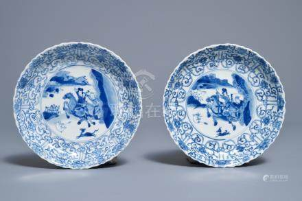 A pair of Chinese blue and white 'Mongolian hunting scene' plates, Chenghua marks, Kangxi