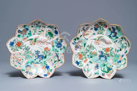 A pair of Chinese famille verte lotus-shaped plates, Kangxi