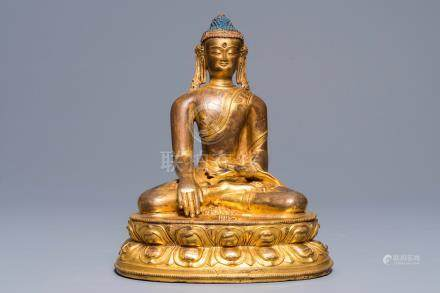 A Sino-Tibetan gilt-copper figure of Buddha Shakyamuni, 17/18th C.