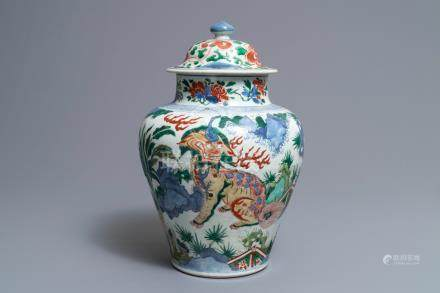 A Chinese wucai 'mythical beasts' vase and cover, Transitional period