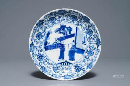 A Chinese blue and white moulded plate with figures on a terrace, Kangxi mark and of the period