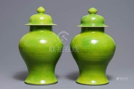 A pair of Chinese yellow and green-glazed vases and covers, 19th C.