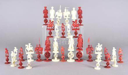 A 19th Century Chinese carved ivory chess set in white and stained red decorated with emperors and