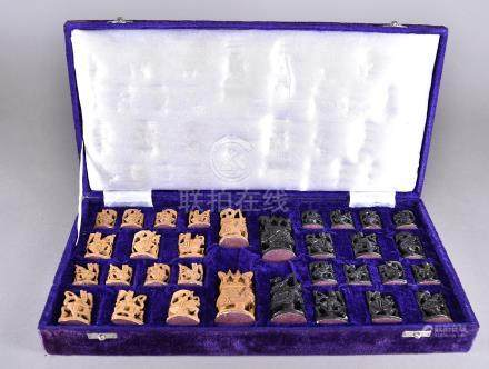 A cased set of Indian chess men, all pieces carved with either elephants, camels or horses in