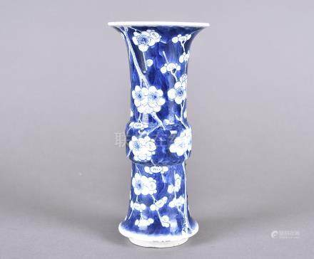 A Chinese blue and white archaic shaped sleeve vase, with blossom design, four character mark, 20 cm
