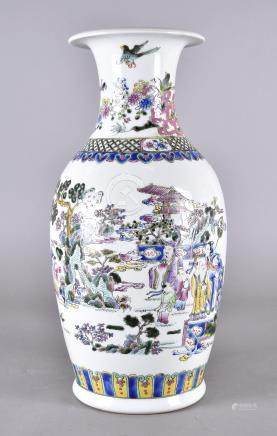 A modern Chinese porcelain famille rose decorated vase, with figures in a fenced landscape below a