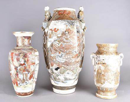 Three large Japanese Meiji period pottery vases, one decorated with seated figures in a landscape,