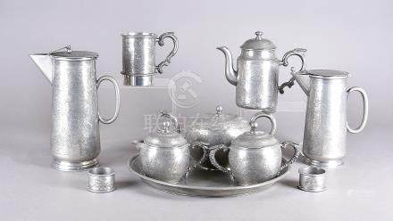 A collection of Chinese Kut Hing Swatow pewter tea and coffee ware, including tea pot, milk jug,
