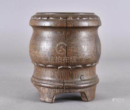 A Chinese palm wood carved brush pot, of archaic shape on four bracket supports, 20.5 cm high x 18