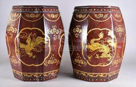 A pair of Chinese lacquered hexagonal barrel stools, red ground with gilt decoration, 45 cm high (