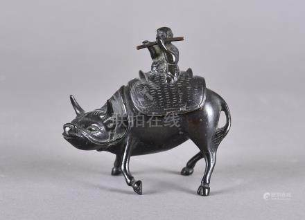 A 19th century Chinese bronze censor, modelled as water buffalo, with lift off lid of a figure