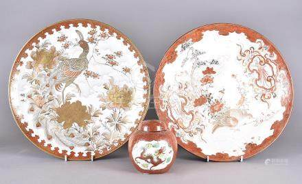 A Japanese Meiji period porcelain charger decorated with Asiatic pheasant together with another