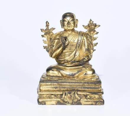 A GILT BRONZE BUDDHA STATUE OF LAMA
