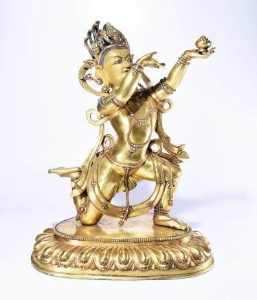 A BRONZE BUDDHA STATUE OF DHARMAPALAS
