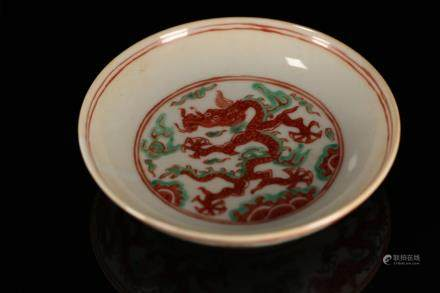 A RED GLAZED DRAGON DISH