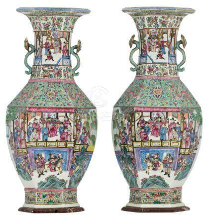An exceptional pair of Chinese turquoise glazed and famille rose hexagonal vases, overall decorated with various court scenes and dragons, the handles ruyi shaped, mounted on marble stands, 19thC, H 91,5 (without stand) - 93,5 cm (with stand)