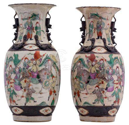 A pair of Chinese polychrome stoneware vases, overall decorated with warriors, marked, about 1900, H 43 - 44,5 cm