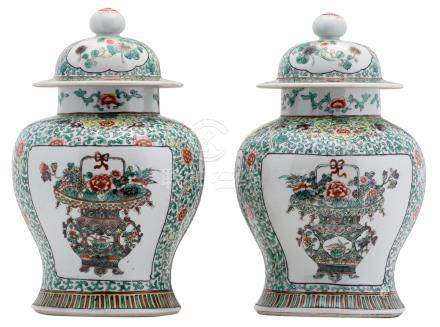 A pair of Chinese famille verte floral decorated vases and covers, the roundels with flower baskets, H 35,5 - 36 cm