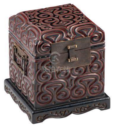 A rare Chinese carved black and cinnabar lacquer seal chest, decorated with pommels, with patinated bronze mounts and handles, Qing dynasty, in a matching box, H 18 - W 16 - D 16 cm