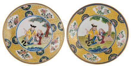 Two Chinese pink and blue back Canton enamel dishes decorated with a European subject, ø 21,5 cm