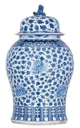 A large Chinese blue and white Kangxi vase and cover, decorated with scrolling peonies and bamboo, the handles Fu lion's head shaped, 18thC, H 65 cm
