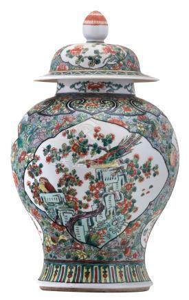 A Chinese famille verte floral decorated vase and cover, the roundels with birds, fish and antiquities, 19thC, H 45,5 cm