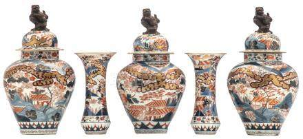 A Japanese five piece imari garniture, decorated with pavilions in a landscape, the covers with Fu lion finals, 19thC, H 32,5 - 51,5 cm