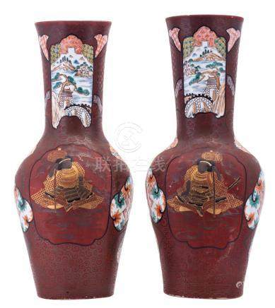 A fine pair of Japanese red lacquered polychrome and gilt decorated porcelain vases, the roundels with figures, flower branches and landscapes, marked, 19thC, H 60,5 - 61 cm