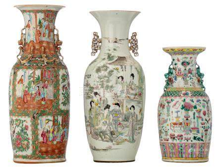 Two Chinese famille rose vases, decorated with a gallant garden scene, flower branches and antiquities, one signed; added a ditto Cantonese vase, H 44,5 - 60 cm