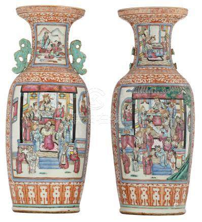 A pair of Chinese ironred and famille rose vases, the panels decorated with court scenes and Immortals, 19thC, H 61 cm