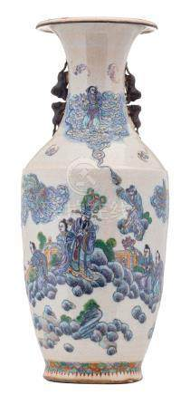 A Chinese polychrome stoneware vase, overall decorated with Immortals, savants and their servants, about 1900, H 64 cm
