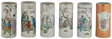 Five Chinese famille rose and polychrome cylindrical vases, decorated with gallant and animated scenes, marked; added a ditto vase, the roundels with a bird and flower branches, H 28 - 28,5 cm