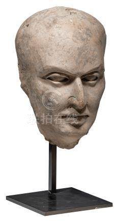 A terracotta portrait of a man, Middle East, probably Gandara, 3 - 4 AD, on an iron mount, (ex Blue Elephant - Maastricht 1990s), H 39 cm