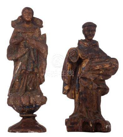 Two religious sculptures, possibly Southern Europe, some traces of polychrome paint, 17th / 18thC; one a female Saint, the other a monk (probably the founder of a religious order), H 22,3 - 25,5 cm