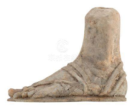 An ancient soft fired terracotta votive left foot dressed in a sandal, Near East, about 3 AD, H 20 - D 25 cm