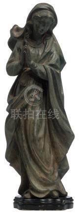 No visible signature, a devout praying woman, oxidising green patinated bronze on a black lacquered wooden base, H 72,5 cm
