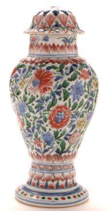 An 18th Century Chinese writhen baluster vase and cover
