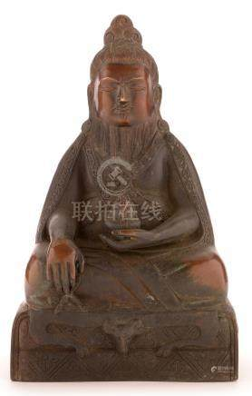 A Chinese bronze figure of a seated bearded...