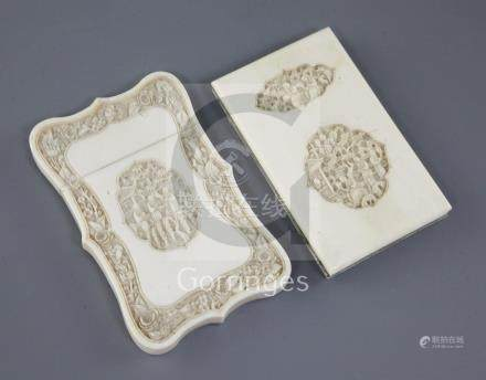 Two Chinese export ivory card cases, 19th century, each carved with figures amid pavilions and