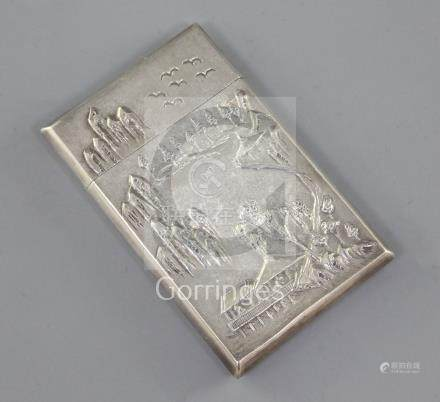A Chinese export silver card case, by Woshing c.1870-1900, embossed with figures in landscape with