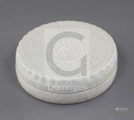 A Chinese Qingbai cosmetics box and cover, Song dynasty, the cover moulded in relief with a